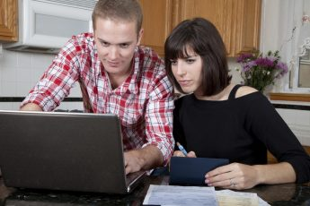 Credit Counselling Couple looking at computer screen